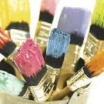 paint brushes with multi colored paint on brushes